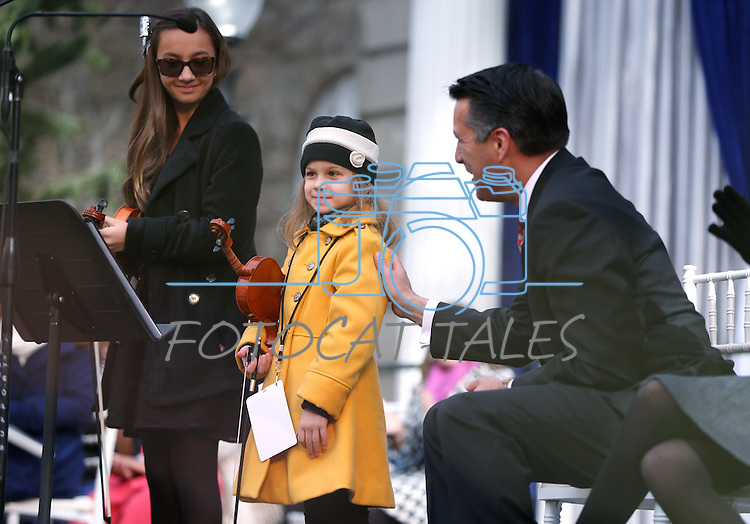 """Gov. Brian Sandoval thanks Haylee Reynolds, 13, and Alexia Ciobanu, 7, for their performance of """"Home Means Nevada"""" at the inauguration at the Capitol, in Carson City, Nev., on Monday, Jan. 5, 2015.<br /> Photo by Cathleen Allison"""