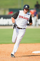 Dan Black #40 of the Kannapolis Intimidators rounds the bases after hitting a home run against the Hagerstown Suns at Fieldcrest Cannon Stadium on May 30, 2011 in Kannapolis, North Carolina.   Photo by Brian Westerholt / Four Seam Images