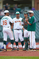 Edgar Michelangeli (16), Christopher Barr (17) and catcher Joe Gomez (40) of the Miami Hurricanes meet with head coach Jim Morris at the mound during the game against the Georgia Tech Yellow Jackets during game one of the 2017 ACC Baseball Championship at Louisville Slugger Field on May 23, 2017 in Louisville, Kentucky. The Hurricanes walked-off the Yellow Jackets 6-5 in 13 innings. (Brian Westerholt/Four Seam Images)