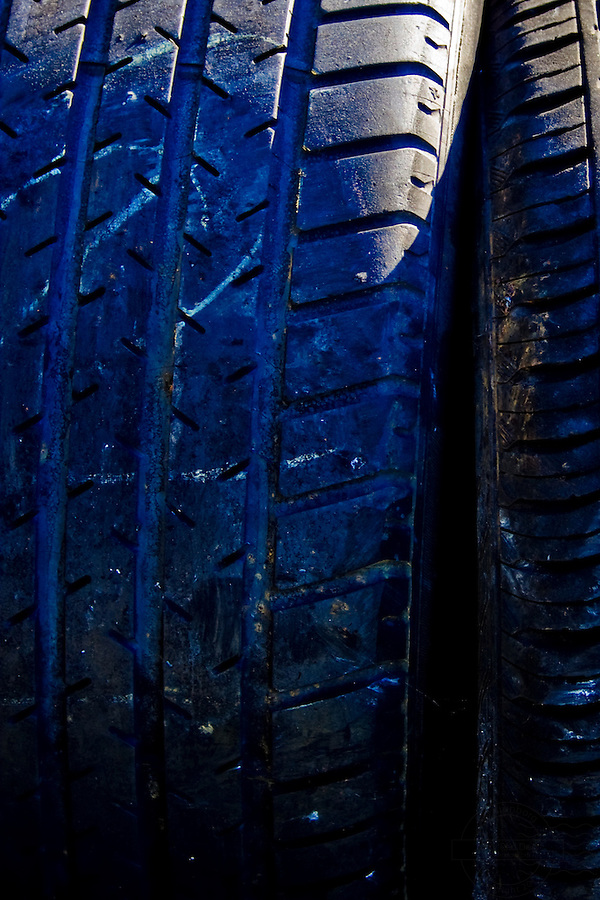 Closeup of tires whith a blue tint