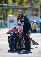 Nov 17, 2019; Pomona, CA, USA; NHRA pro stock motorcycle rider Andrew Hines reacts after losing in the first round on a red light during the Auto Club Finals at Auto Club Raceway at Pomona. Mandatory Credit: Mark J. Rebilas-USA TODAY Sports