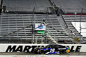 MARTINSVILLE, VIRGINIA - JUNE 10: Martin Truex Jr., driver of the #19 SiriusXM Toyota, crosses the finish line to win the NASCAR Cup Series Blue-Emu Maximum Pain Relief 500 at Martinsville Speedway on June 10, 2020 in Martinsville, Virginia. (Photo by Jared C. Tilton/Getty Images)