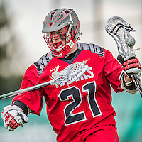 18 April 2015: University of Hartford Hawk Attacker Justin Huggins, a Freshman from Caledon, Ontario, in action against the University of Vermont Catamounts at Virtue Field in Burlington, Vermont. The Cats defeated the Hawks 14-11 in the final home game of the 2015 season. Mandatory Credit: Ed Wolfstein Photo *** RAW (NEF) Image File Available ***