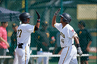 Pittsburgh Pirates catcher Raul Hernandez (38) high fives Michael de la Cruz (27) after hitting a home run during an Instructional League intrasquad black and gold game on October 11, 2017 at Pirate City in Bradenton, Florida.  (Mike Janes/Four Seam Images)