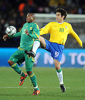 Kaka of Brazil and Kagisho Dikgacoi of South Africa. Brazil defeated South Africa 1-0 during the semi-finals of the FIFA Confederations Cup at Ellis Park Stadium in Johannesburg, South Africa on June 25, 2009..