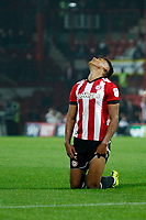 Ollie Watkins of Brentford looks to the heavens for luck during the Sky Bet Championship match between Brentford and Derby County at Griffin Park, London, England on 26 September 2017. Photo by Carlton Myrie / PRiME Media Images.