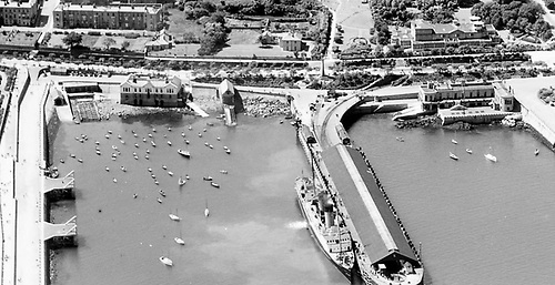 Aerial view of the southeast corner of Dun Laoghaire Harbour at low water Springs in 1933
