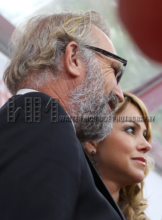 Kevin Costner and wife Christine Baumgartner arrive at  the 'Black and White' premiere during the 2014 Toronto International Film Festival at Roy Thomson Hall on September 6, 2014 in Toronto, Canada.
