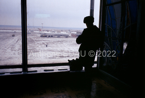"""Moscow, Russia<br /> Soviet Union<br /> December 19, 1991<br /> <br /> A shortage of fuel strands passengers at Domodedov Airport, the main domestic airport in Russia.<br /> <br /> In December 1991, food shortages in central Russia had prompted food rationing in the Moscow area for the first time since World War II. Amid steady collapse, Soviet President Gorbachev and his government continued to oppose rapid market reforms like Yavlinsky's """"500 Days"""" program. To break Gorbachev's opposition, Yeltsin decided to disband the USSR in accordance with the Treaty of the Union of 1922 and thereby remove Gorbachev and the Soviet government from power. The step was also enthusiastically supported by the governments of Ukraine and Belarus, which were parties of the Treaty of 1922 along with Russia.<br /> <br /> On December 21, 1991, representatives of all member republics except Georgia signed the Alma-Ata Protocol, in which they confirmed the dissolution of the Union. That same day, all former-Soviet republics agreed to join the CIS, with the exception of the three Baltic States."""