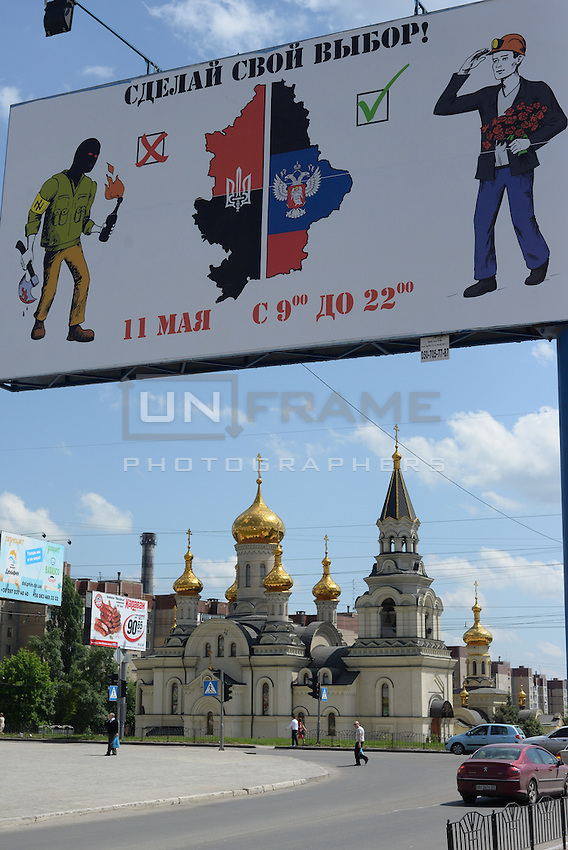 Donetsk goes to the polls for self determination.  Banners in the streets exhort citizens to vote for a yes.  Donetsk, Ukraine.