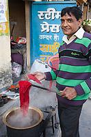 India, Dehradun.  Man Dying Cloth.