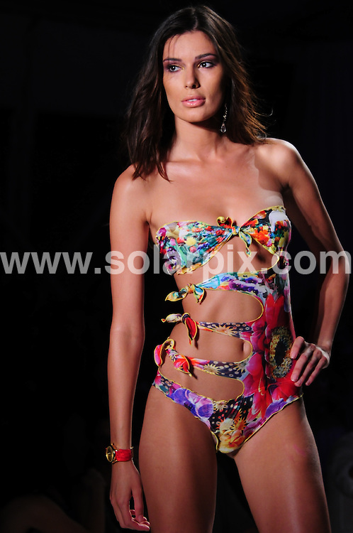 **ALL ROUND PICTURES FROM SOLARPIX.COM**.**SYNDICATION RIGHTS FOR UK, AUSTRALIA, DENMARK, PORTUGAL, S. AFRICA, SPAIN & DUBAI (U.A.E) & ASIA (EXCLUDING JAPAN) ONLY**.Luli Fama runway show at the Mercedes-Benz Fashion Week Swim 2011, held at the Raleigh Hotel, Miami, FL, USA. 18 July 2010..This pic: Luli Fama runway show..JOB REF: 11716 PHZ Dalaeli   DATE: 18_07_2010.**MUST CREDIT SOLARPIX.COM OR DOUBLE FEE WILL BE CHARGED**.**MUST NOTIFY SOLARPIX OF ONLINE USAGE**.**CALL US ON: +34 952 811 768 or LOW RATE FROM UK 0844 617 7637**