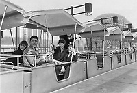 1967 FILE PHOTO - ARCHIVES -<br /> <br /> It's fun getting around Expo; and there are nine ways to do it. Mr. and Mrs. Clement Plante; Daniella; 13 and Bobby; 10; plumped for this exciting mini-rail to take them on a 'trip around the world.' It's one of three minirails at the fair.<br /> <br /> 1967<br /> <br /> PHOTO : Boris Spremo - Toronto Star Archives - AQP