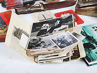 BNPS.co.uk (01202 558833)<br /> Pic: LindsayBurns/BNPS<br /> <br /> Pictured: Marine Jock Mathieson's  photographs.<br /> <br /> The medals, weapons and personal effects of a hero D-Day commando have sold for over £11,000 - 22 times their estimate.<br /> <br /> Marine Jock Mathieson narrowly escaped death during the Normandy landings on June 6, 1944.<br /> <br /> A bullet pierced the fuel tank of his motorbike which he was carrying above his head while wading through the sea towards Juno Beach.
