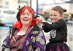 Holy Family school teacher Trina Waters and pupil Jenny Hehir attending a public performance in the Market before the annual  Clare Champion Halloween Party. Photograph by John Kelly.