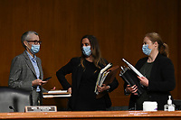 Masked staff talk before a United States Senate Judiciary Committee hearing examining best practices for incarceration and detention during the coronavirus disease (COVID-19) pandemic in Washington, U.S., June 2, 2020. <br /> Credit: Erin Scott / Pool via CNP/AdMedia