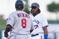 AFL West third baseman Vladimir Guerrero Jr. (27), of the Surprise Saguaros and Toronto Blue Jays organization, talks to AFL East manager Tommy Watkins (8) during the Arizona Fall League Fall Stars game at Surprise Stadium on November 3, 2018 in Surprise, Arizona. The AFL West defeated the AFL East 7-6 . (Zachary Lucy/Four Seam Images)
