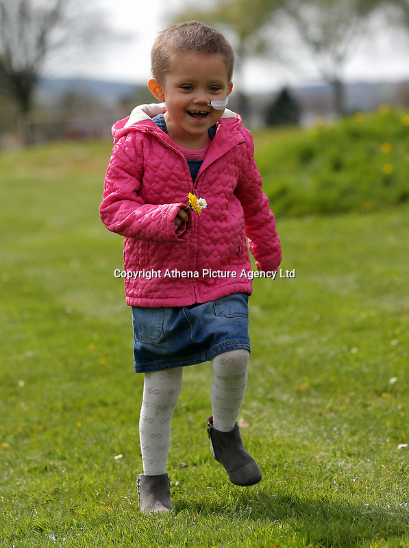 """COPY BY TOM BEDFORD<br /> Pictured: Mia Chambers running <br /> Re: One of Britain's poorest towns is raising £100,000 to send a little girl to America because the lifesaving drugs she needs are not available on the NHS.<br /> Brave Mia Chambers, five, is in remission after having an ovary and kidney removed due to neuroblastoma, a rare and aggressive type of cancer.<br /> Doctors have told her parents Josh and Kirsty there is a 50 per cent chance of the cancer returning without the specialist drugs.<br /> Josh, 28, said: """"That's not a chance we are prepared to take - the odds are too high.<br /> """"We researched it on the internet and found children in the US are beating this terrible illness.<br /> """"Doctors there are willing to treat her but it will cost more money than we have.""""<br /> The couple's plight has touched the hearts of people in their home town of Merthyr Tydfil, South Wales, and money has begun pouring in.         <br /> Mia had chemotherapy on the Rainbow ward at the Noah's Ark Children's Hospital for Wales where nurses nicknamed her the Rainbow Warrior because of her fighting spirit."""