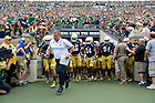 Aug. 31, 2013; Head coach Brian Kelly runs out to the field with his team before kickoff against Temple. Photo by Barbara Johnston/University of Notre Dame