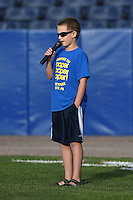 Young fan sings the national anthem before a Batavia Muckdogs game against the Jamestown Jammers on July 25, 2014 at Dwyer Stadium in Batavia, New York.  Batavia defeated Jamestown 7-2.  (Mike Janes/Four Seam Images)