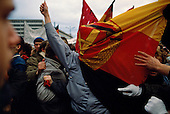 Karl-Marx-Stradt, Germany<br /> March, 1990<br /> <br /> Battling over and East German flag - a symbol opposing quick reunification of East and West Germany during a pre-election rally.<br /> <br /> Following the initial opening of the Berlin Wall on November 9, 1989, new elections were held on March 18, 1990, and the governing party, the SED, lost its majority in the Volkskammer (the East German parliament). On August 23, the Volkskammer decided that the territory of the Republic would unify with West Germany to form the Federal Republic of Germany on October 3, 1990. As a result of the unification the German Democratic Republic ceased to exist.