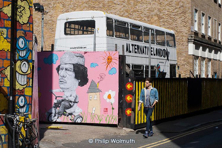 Alternative London.  Colonel Gaddafi wall art in Shoreditch, London.