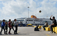 Pictured: Young children play with a ball at Piraeus port, Greece Sunday 28 February 2016<br /> Re: Hundreds of migrants have arrived from the Greek islands to Piraeus Port, Greece