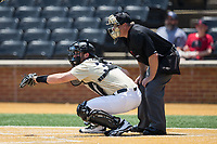 Wake Forest Demon Deacons catcher Ben Breazeale (39) reaches for a pitch as home plate umpire Darion Padgett looks on during the game against the Pitt Panthers at David F. Couch Ballpark on May 20, 2017 in Winston-Salem, North Carolina. The Demon Deacons defeated the Panthers 14-4.  (Brian Westerholt/Four Seam Images)