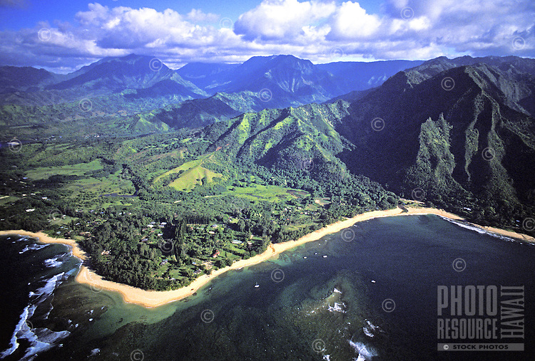 Aerial of the north coast of Kauai with lush green mountains