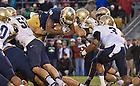 Nov. 2, 2013; Running back Tarean Folston (25) dives over the goal line for the game-winning touchdown against Navy.<br /> <br /> Photo by Matt Cashore