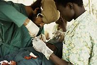 Surgery in Sara, Guinea-Bissau - Cuban nurse checking blood pressure - 1974