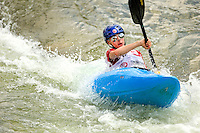 Young kayakers (model released) learns the skill of whitewater kayaking while participating in a summer camp program at the US National Whitewater Center (USNWC) in Charlotte, NC.