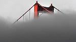 San Francisco fog creeps past the Golden Gate Bridge.