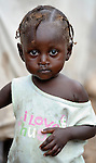 """A young girl living in a """"tent city"""" of homeless earthquake survivors in the Bobin neighborhood of Port-au-Prince, Haiti. The January 2010 earthquake ravaged the capital, killing some 300,000 people and leaving more than 1.3 million homeless."""