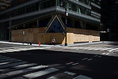 New York New York<br /> June 7, 2020<br /> <br /> After several nights of looting, nearly all ground level windows in Midtown Manhattan are covered with plywood. Many of the shops had already been looted others are boarded for protection.