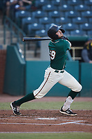 Jared Triolo (19) of the Greensboro Grasshoppers follows through on his swing against the Hickory Crawdads at First National Bank Field on May 6, 2021 in Greensboro, North Carolina. (Brian Westerholt/Four Seam Images)