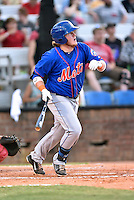 Kingsport Mets first baseman Dash Winningham (10) swings at a pitch during a game against the  Johnson City Cardinals on June 25, 2015 in Johnson City, Tennessee. The Mets defeated the Cardinals 10-8 (Tony Farlow/Four Seam Images)