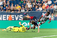 FOXBOROUGH, MA - JULY 7: Brad Knighton #18 of New England Revolution covers the ball as Henry Kessler #4 of New England Revolution and Ayo Akinola #20 of Toronto FC collide during a game between Toronto FC and New England Revolution at Gillette Stadium on July 7, 2021 in Foxborough, Massachusetts.