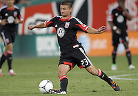 WASHINGTON, DC. - AUGUST 22, 2012:  Perry Kitchen (23) of DC United controls the ball against the Chicago Fire during an MLS match at RFK Stadium, in Washington DC,  on August 22. United won 4-2.
