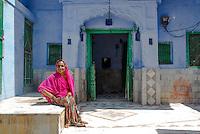 A Beautiful Woman sitting outside her home in Sambhar, Rajasthan