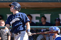 Michael Ratterree (5) of the Helena Brewers follows through on his swing against the Ogden Raptors at Lindquist Field on July 21, 2013 in Ogden Utah. (Stephen Smith/Four Seam Images)