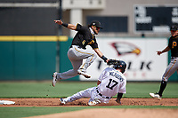 Pittsburgh Pirates shortstop Francisco Acuna (6) tags Parker Meadows (17) out while sliding into the second base during a Florida Instructional League game against the Detroit Tigers on October 16, 2020 at Joker Marchant Stadium in Lakeland, Florida.  (Mike Janes/Four Seam Images)