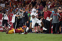 LOS ANGELES, CA - SEPTEMBER 11: Nathaniel Peat #8 of the Stanford Cardinal breaks a tackle attempt by Micah Croom #17 of the USC Trojans for a touchdown during a game between University of Southern California and Stanford Football at Los Angeles Memorial Coliseum on September 11, 2021 in Los Angeles, California.