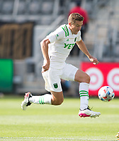 LOS ANGELES, CA - APRIL 17: Matt Besler #5 of Austin FC moves with the ball during a game between Austin FC and Los Angeles FC at Banc of California Stadium on April 17, 2021 in Los Angeles, California.