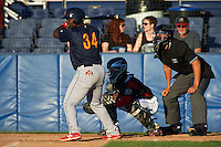 State College Spikes right fielder Bladimil Franco (34) at bat in front of catcher Pablo Garcia and umpire Raul Moreno during a game against the Batavia Muckdogs on June 23, 2016 at Dwyer Stadium in Batavia, New York.  State College defeated Batavia 8-4.  (Mike Janes/Four Seam Images)