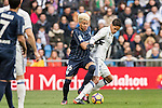 Raphael Varane (r) of Real Madrid competes for the ball with Adalberto Penaranda of Malaga CF during their La Liga 2016-17 match between Real Madrid and Malaga CF at the Estadio Santiago Bernabéu on 21 January 2017 in Madrid, Spain. Photo by Diego Gonzalez Souto / Power Sport Images