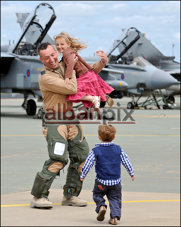 RAF Pilots greet their family's as they return to RAF Marham in Norfolk