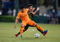 LAKE BUENA VISTA, FL - JULY 18: Memo Rodríguez #8 of the Houston Dynamo fights off Eryk Williamson #30 of the Portland Timbers for possession during a game between Houston Dynamo and Portland Timbers at ESPN Wide World of Sports on July 18, 2020 in Lake Buena Vista, Florida.