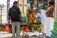 Hindu Priests and Temple Workers Discussing Placement of Temple Deity, Sri Mahamariamman Hindu Temple, Kuala Lumpur, Malaysia.