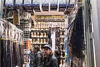 """FRANKREICH, 26.11.2015, Paris.  Der Vorort-Bezirk Saint-Denis ist gepraegt durch seine vielen muslimischen Zuwanderer. Hier liegt das """"Stade de France"""", einer der Orte der Terroranschlaege vom 13.11 und hier lieferte sich die Polizei die schwere Schiesserei mit einigen der beteiligten Islamisten am 18.11. - Haarmodeladen.   The suburban district of Saint-Denis is characterized by its dense muslim immigrant population. Here """"Stade de France"""" is located, one of the places of the Paris terrorist attacks on Nov. 13 and here the police had a heavy shootout with some of the islamists involved on Nov. 18. - Hair fashion shop.<br /> � Arturas Morozovas/EST&OST"""